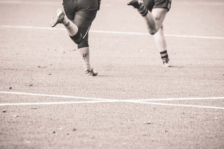 2 rugby players chasing each other