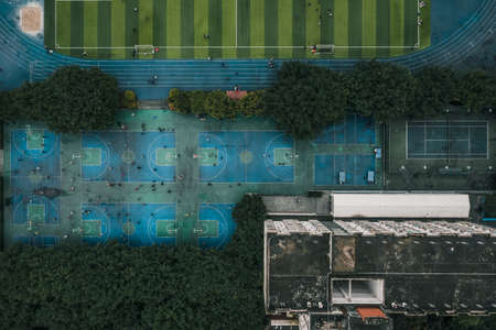 Photo pour Aerial overhead drone shot of basketball and football field at middle school in Chongqing, southwest China - image libre de droit