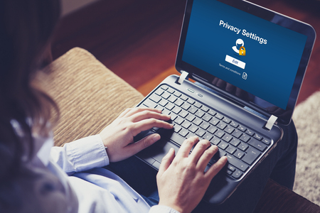 Photo pour Privacy settings on the screen. Woman with a laptop on the knees. - image libre de droit