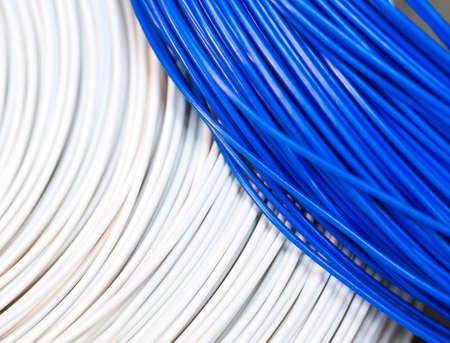 Photo pour close up a roll of white and blue cable as a background - image libre de droit