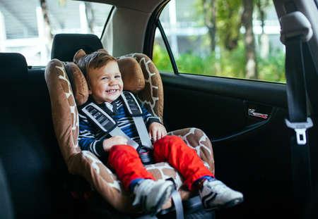 Photo pour Adorable baby boy in a safety car seat. - image libre de droit