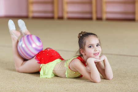 Photo pour Young girl doing gymnastics in the gym. - image libre de droit