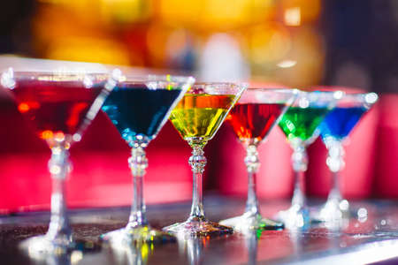 Photo for Multicolored cocktails at the bar on the wooden table. - Royalty Free Image
