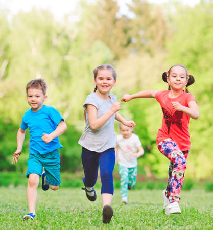Photo for Many different kids, boys and girls running in the park on sunny summer day in casual clothes. - Royalty Free Image