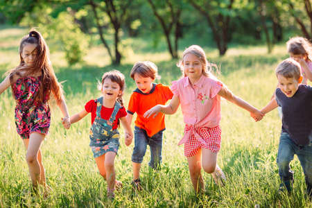 Photo for Large group of kids, friends boys and girls running in the park on sunny summer day in casual clothes . - Royalty Free Image