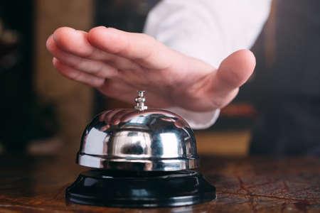 Photo pour Restaurant bell vintage with hand. Hotel service bell - image libre de droit