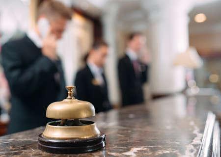 Photo pour Hotel service bell Concept hotel, travel, room,Modern luxury hotel reception counter desk on background. - image libre de droit