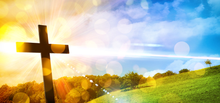 Photo pour Religious illustration with backlit cross with golden glitter and bokeh and nature landscape background. Horizontal composition - image libre de droit