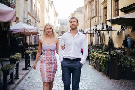 Photo pour Smiling couple in love outdoors, lviv. summer - image libre de droit