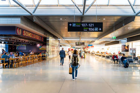 Photo pour Dublin, Ireland, May 2019 Dublin airport, people rushing for their flights, departure hall with moving walkway, motion blur - image libre de droit