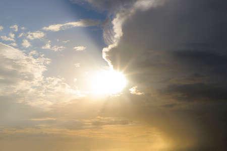 Foto de The sun after the storm comes out of the clouds. - Imagen libre de derechos