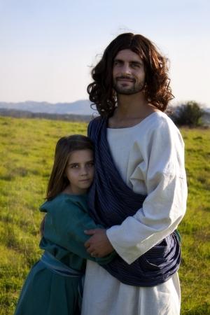 Jesus embracing a child