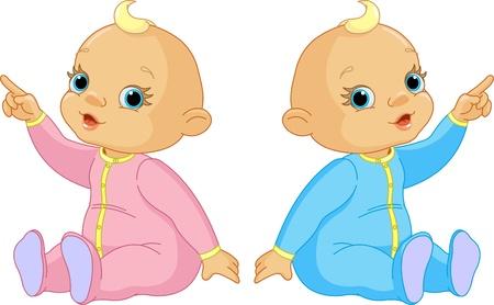 Foto de Two adorable babies - the girl and the boy pointing - Imagen libre de derechos