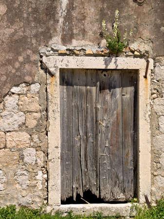 Old fisherman house detail of wooden door. Location: island Sipan near Dubrovnik, Croatia.