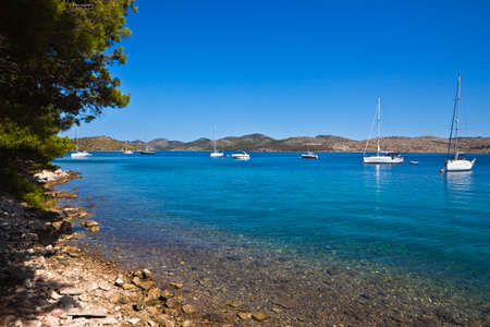 Mediterranean landscape - island Dugi otok, National Park Telascica. Sailboats in bay with a beach