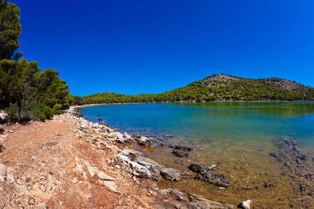 Mediterranean landscape - beach on island Dugi otok, National Park Telascica. Salt lake. Shot with fish eye lens