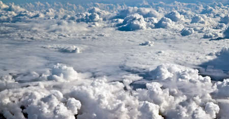 Airplane shot above clouds.