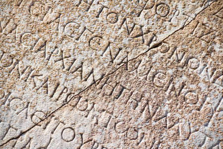 Detail with Roman inscription on latin language in Ephesus (Efes), Turkey.