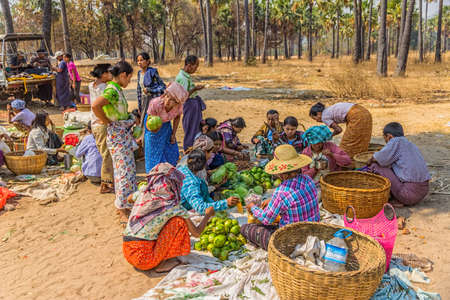 BAGAN, MYANMAR - FEBRUARY 24: Women are selling vegetables at the local market on February 24, 2013 in Bagan, Myanmar. All the food is organically grown.