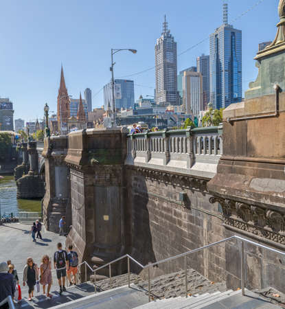 MELBOURNE, AUSTRALIA - MARCH 21, 2015: View of Princes bridge from Southbank showing Cathedral of Saint Paul and apartment architecture on the beautiful sunny day.