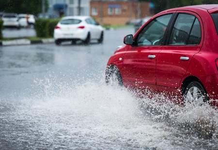 Photo for motion car rain big puddle of water spray from the wheels - Royalty Free Image