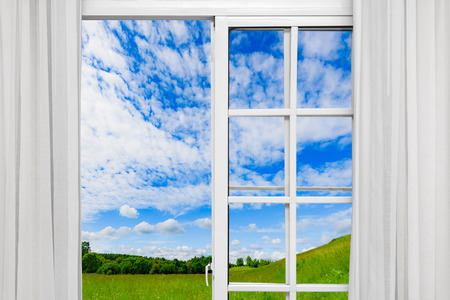 Foto de nature landscape with a view through a window with curtains - Imagen libre de derechos