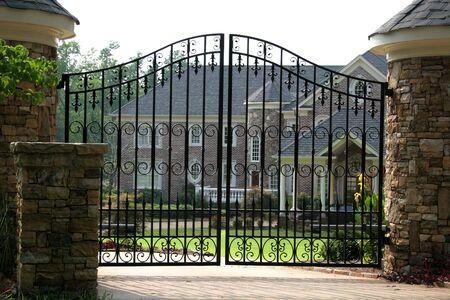 Brick mansion behind iron gate