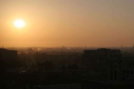 A sunrise through the smog of south LA suburb