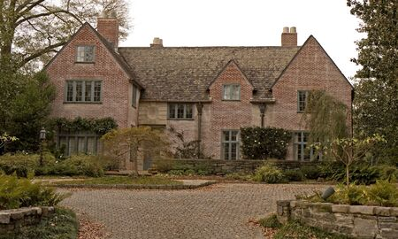 An old brick mansion and driveway on an estate