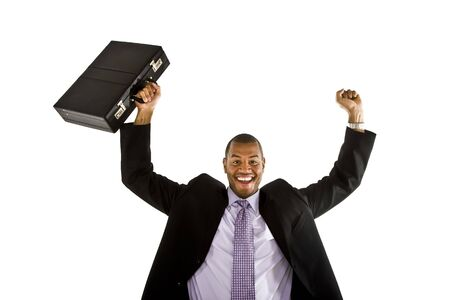 A black man in a business suit raising his briefcase and fist over his head in triumph or winning a job or deal