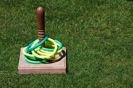 A classic game of ring toss on a green lawn
