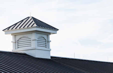 White wood cupola on metal roof of an old pier