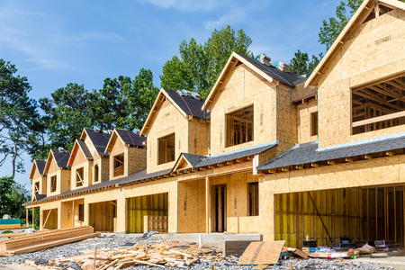 Photo for New Row House Construction with wood sheathing and asphalt roof - Royalty Free Image