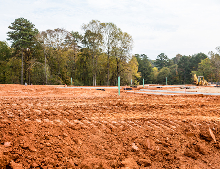 Foto de Dirt graded for roads in a residential construction site with new concrete curbs - Imagen libre de derechos