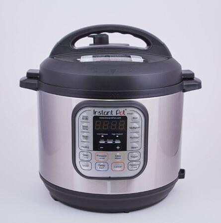 Photo pour An InstaPot pressure cooker on a white backgrouind - image libre de droit
