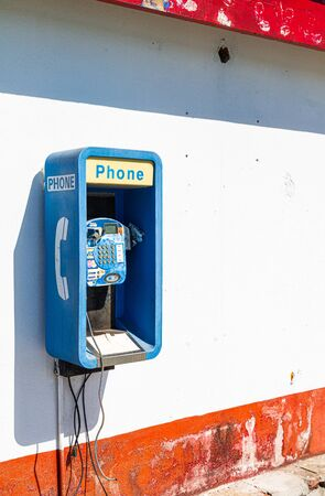 BERMUDA - December 7, 2016: Payphones were ubiquitous around the world, but their prevalence has decreased significantly over the years due to the increasing availability of mobile phones.