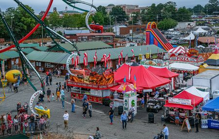 Photo for CUMMING, GEORGIA - October 6, 2019: County and local fairs and carnivals are still some of the best values in family entertainment - Royalty Free Image