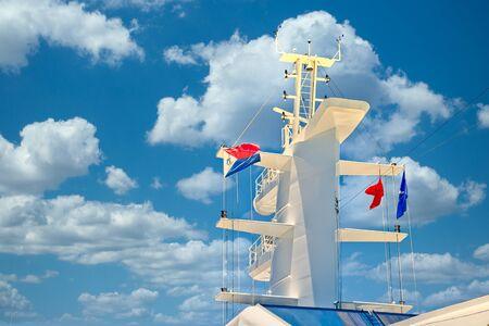 Photo pour Ship Tower with Colorful Flags - image libre de droit