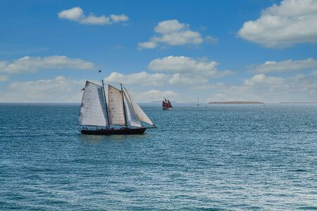 Photo for White Sails with Red Sails on Horizon - Royalty Free Image