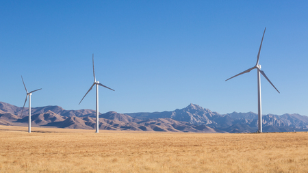 Three windmills are a part of a large wind farm in Southern Utah near the town of Milford. In the background is the iconic Granite Peak of the Mineral Mountains
