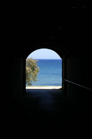 An underground tunnel leading to the seaside