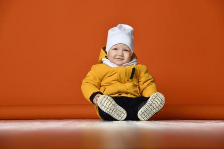 Foto de Children in winter clothes. Kids in down jackets. Fashion child - Imagen libre de derechos