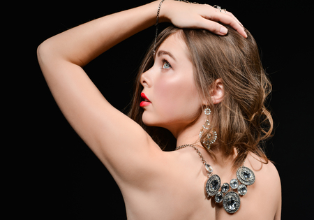Foto de beautiful back of a young woman with a necklace on her naked back. Elegant fashion glamor photo - Imagen libre de derechos