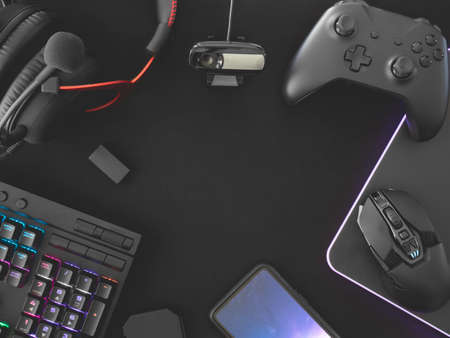 Photo pour streaming games concept, top view a gaming gear, mouse, Webcams, keyboard, joystick, headset and mouse pad on black table background. - image libre de droit