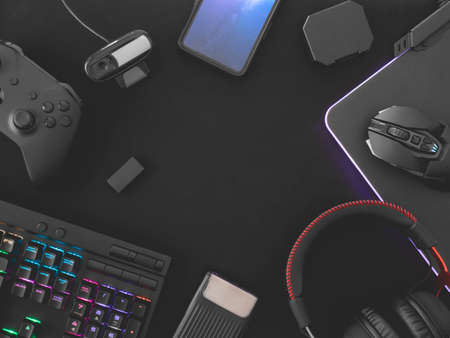 Photo for streaming games concept, top view a gaming gear, mouse, Webcams, keyboard, joystick, headset and mouse pad on black table background. - Royalty Free Image