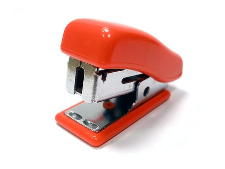 small red stapler on the white isolate background