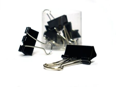 black paper clip on the white background