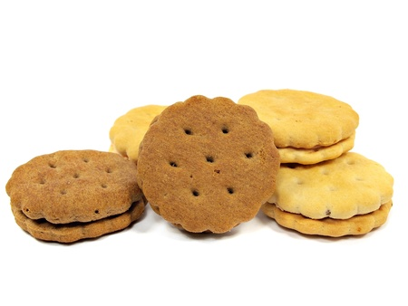 sandwich biscuits with cream and chocolate fillings on a white background