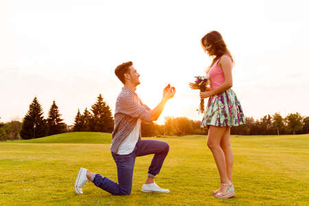 Photo for young man makes a proposal of betrothal to his girlfriend - Royalty Free Image