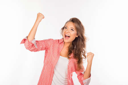 Happy girl showing successful achieving the goal